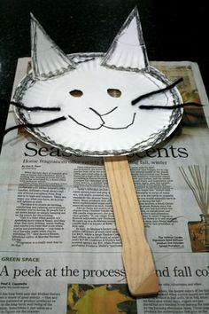 Pair this craft with The Kids Cat Book by Tomie de Paola:  what a fun idea!