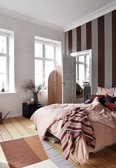 my scandinavian home: Burgindy and grey striped wallpaper and pale pink in the bedrom of 'The Home', Copenhagen Photo: These Four Walls.