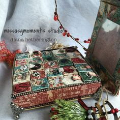 Advent Calendar.  Container box is a Graphic 45 8x8 matchbook.  Inside boxes made from Eileen Hull Sizzix Die: Sizzix ScoreBoards XL Die - Block/Cube/Bank, 3-D