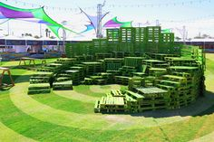 malka architecture uses stacked green pallets to build public arenas in las vegas