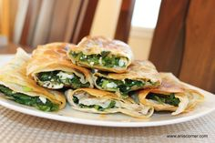 Spinach Wraps 2 bunches spinach, 1 bunch parsley, 2 bunches green onion, 1-1 1/2 cup feta cheese, 1 lemon juice, 3 Lavash (wraps or tortillas would be fine too),  4 Tbsp olive oil