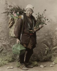 Old woman selling small woods for Ikebana (?), 1880 by Tamamura Kozaburo