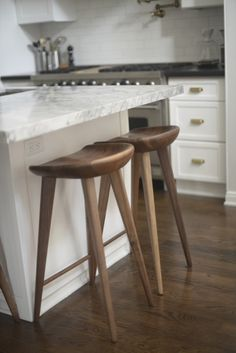 WANT WANT WANT these bar stools. I just weighed mine - about 30 #s each - hard to scoot in, trip over them.