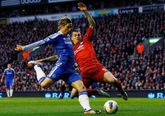 Liverpool v Chelsea: Liverpool's Daniel Agger challenges Chelsea's Fernando Torres
