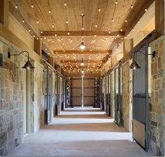 Tuscan-style stable with white string lights running along ceiling - great barn idea for the holidays or all year round!