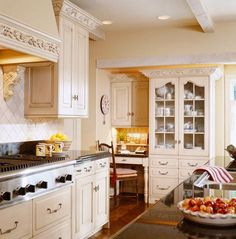 Interior Designer Charles Faudree: French Flair~The peanut color used in the family room (shown on a previous slide{family room photo is pinned in Country French}) continues on the cabinets in the connecting kitchen.