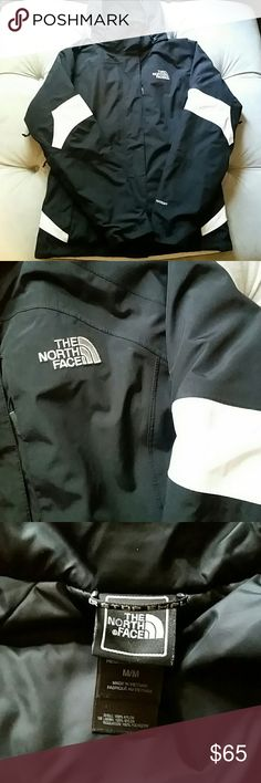 Black and white The North Face jacket size medium Great condition authentic black and white The North Face jacket. Removable black nylon liner jacket (can be worn on its own), zippered pockets with fleece lining. Removable hood. Shell and lining 100% nylon, insulation 100% poly. O on tags have been marked to prevent return. Great rain jacket or fall/winter jacket . Size women's medium The North Face Jackets & Coats