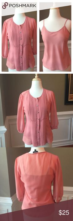 "Talbots peach blouse & cami set Like new!! From Talbot's Petites. A stunning set in a peachy color. The semi-sheer blouse has pleating down the front and silver buttons with 3/4 length sleeve. Matching spaghetti strap cami pairs underneath. No rips, stains, odors, snags or pilling. Smoke and pet-Free home. Blouse measures approx 18"" across bust, 22"" long, 16"" sleeves. Bundle/make offer! Talbots Tops Blouses"