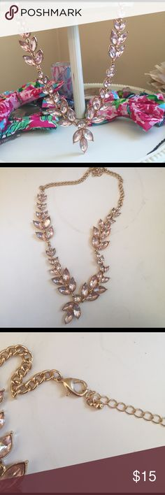 Peach colored gemstone necklace costume jewelry The necklace itself is it great condition but the glue used attach the stones is dark in some areas and visible through the stones. I never noticed it until looking closely to list this, however, so I doubt it would be noticeable when wearing Jewelry Necklaces