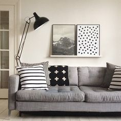 gray, warm white, black and white patterns. gray toned b photo. Posters on a picture ledge. strong lamp