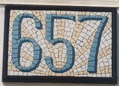 """Rather neat-o looking house numbers done in mosaic - I especially like the shadowing. """"Made inside a simple, metal picture frame."""""""