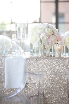 glittery silver table cloth + mirrored vase + blush peonies