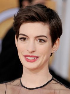 Anne Hathaway Shows You 10 Inventive Ways to Wear a Pixie: When you want to get short hair out of your face, try Annes look from the SAG Awards. Use a bit of pomade and a blow dryer to smooth bangs up and back.