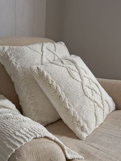 Cable Knit Cushion from Nordic House. Wonderfully textured cable knit cushion in a soft Old White. Perfect for snuggling up to on a autumn or winter's eve..