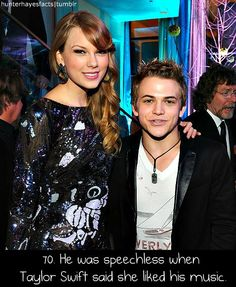 Even though Taylor Swift is tall, it looks to me like she's wearing high heels in this picture.
