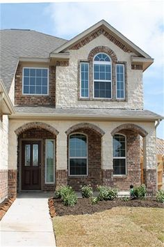Stucco And Brick Exterior love the color of brick and stone. love the pointed tall entryway