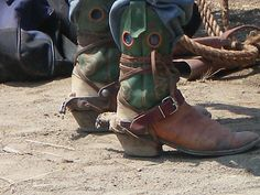 Well worn dusty boots with spurs