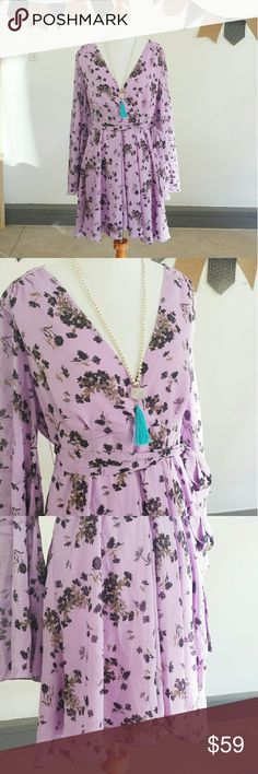 {H.P} {Free People} Lavender Floral Boho Dress Free People Lavender Floral Boho Dress.  V-Neck With Side Zipper & Sash Around Waist. Bell Sleeves. EUC (EXCELLENT USED CONDITION). **TINY SNAG ON ONE SLEEVE UNABLE TO DETECT UNLESS YOU KNOW IT IS THERE.** >MEASUREMENTS  Length Bust Arm/Sleeve   Please Ask Questions Before Purchasing  ALL SALES ARE FINAL  NO TRADES NO PAYPAL  NO HOLDS NO LOW BALL OFFERS Free People Dresses Mini