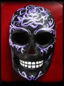 Really what Im looking for with black mask a more voodoo and maybe even day of the dead like face