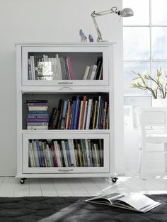 I'd love to do this to my gram's old barrister bookcase. Off white or maybe green.