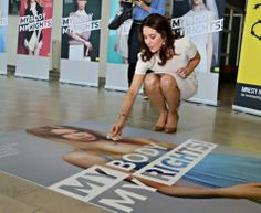 Noblesse & Royautés:  Crown Princess Mary attended an Amnesty International convention in Denmark-here she puts in a puzzle piece, April 28, 2014