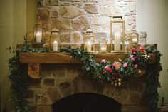 daydreaming... lanterns and mantle draped with vines and flowers...
