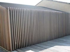 Timber Cladding over Steel and Glass