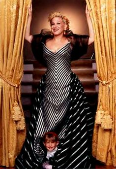 From a Distance lyrics were written in 1985 by American singer-songwriter, Julie Gold but became an international success through Bette Midler in 1990 Bette Midler, Badass Women, Celebs, Celebrities, American Singers, Comedians, Movie Stars, Dress Up, Gowns