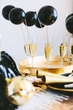 New Year's Eve Party must-have: a champagne bar complete with balloon drink stirrers!