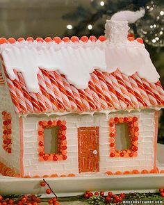 Sugar cubes and royal icing serve as the bricks and mortar for this confectionery Christmas house. Add a few architectural details -- peppermint sticks for roof shingles, jelly beans to line the windows, and rock candy along the rooftop. Gingerbread House Parties, Christmas Gingerbread House, Noel Christmas, Christmas Goodies, Christmas Treats, Christmas Baking, Christmas Decorations, Gingerbread Houses, Christmas Houses