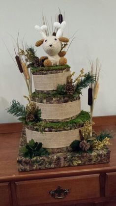 Hunting themed diaper cake I made. SUPER CUTE!! Even crocheted the deer.