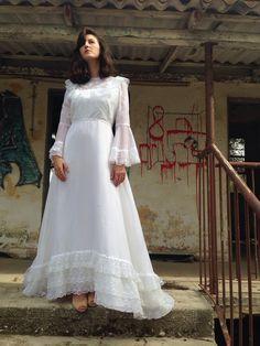 A personal favorite from my Etsy shop https://www.etsy.com/il-en/listing/253277500/sale-beautiful-vintage-wedding-dress