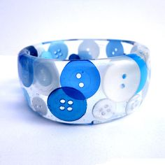 Hey, I found this really awesome Etsy listing at https://www.etsy.com/listing/110614661/blue-and-white-button-in-resin-bangle