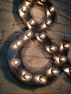 Ampersand  Letter metal industrial 24 inches tall by 18 inches wide. $147.06, via Etsy.