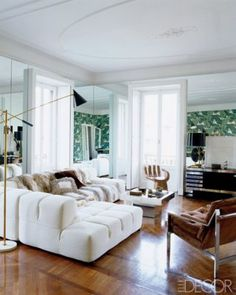Large white wrap-around couch. Hardwood floors. Fur throw. I want to curl up on it NOW.