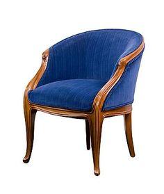 French Art Nouveau Arm Chair by, Louis Majorelle    French Art Nouveau carved walnut bergère (armchair) by, Louis Majorelle upholstered in a striped blue velvet fabric. circa 1900