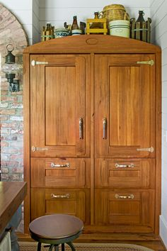 """Surprise! Inside this convincingly """"old"""" heart-pine icebox are all the modern conveniences of a Sub-Zero fridge."""