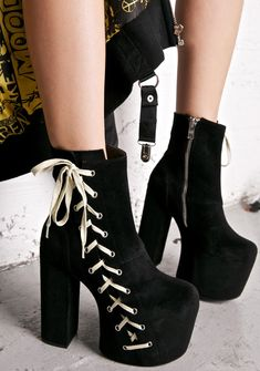 Current Mood Sideshow Boots all eyes are on you now, babe… These insane boots feature a luxxx black vegan suede construction, sky-high covered platform 'N block heel, statement full length lace-up detailing on the outward facing side, and inner ankle zip closures for a sleek fit.