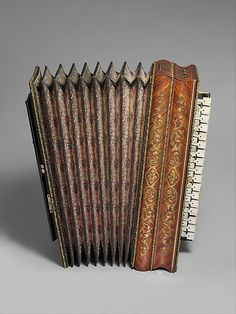 "1860 French Accordion at the Metropolitan Museum of Art, New York - From the curators' comments: ""In the 1830s, Paris became a major center of accordion production, which flourished until the Franco-Prussian War of 1870-71. To compete with makers in Austria and Germany, Paris manufacturers successfully marketed their instruments by applying rich and costly decoration."""