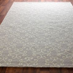 Scrolling Medallion Hooked Rug. Pretty in gray