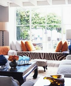 Brown zebra and orange accents? I could easily do this with my living room!
