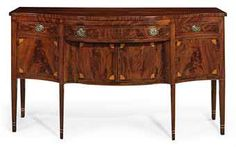 A FEDERAL INLAID MAHOGANY SERPENTINE-FRONT SIDEBOARD