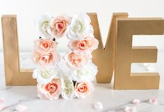 Paper Mache Floral Letter Centerpiece. Perfect for a wedding guest signing table or dessert table.