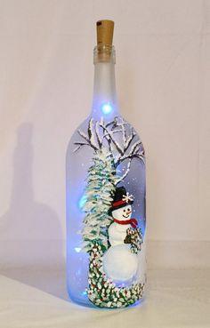 Snowman Wine Bottle - Christmas illuminated bottle of snowman painted wine bottle Glass Bottle Crafts, Wine Bottle Art, Painted Wine Bottles, Lighted Wine Bottles, Large Bottle Of Wine, Bottle Bottle, Vintage Bottles, Vintage Perfume, Wine Bottle Centerpieces