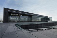 OMA envisions G-Star RAW HQ in amsterdam as airport hangar