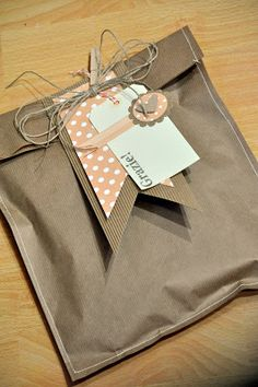 brown paper bag gift wrap - just sew around the edge to give it a different look!