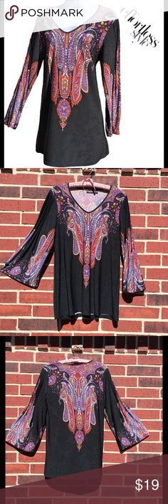 Colorful 3/4th Sleeve Tunic Effortless Style Size M(10-12) Bust 20 in, Length 29 in.  Excellent condition. Pleated, printed perfection! This is a wear-everywhere tunic that's as fashionable as it is fuss-free. With romantic pleating on the shoulders & 3/4-length bell sleeves, this tunic is a classic w/ its rich, transitional color palette makes it ideal for fall/winter. A subtle, tonal animal print backs the paisley pattern for modern flair. Great floaty, feminine silhouette-it's…