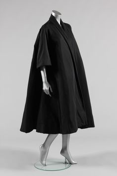 Black faille tent coat, of voluminous cut, self-lined, Balenciaga, 1950s,
