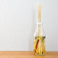 Take bamboo skewers and put them in a bottle filled with essential oil, rubbing alcohol, and more, for a neat scent diffuser. Photo: Sarah Lipoff