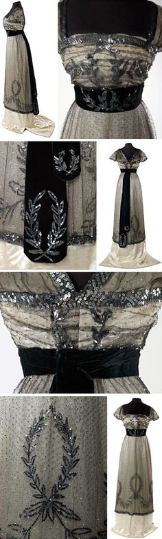 """Evening dress, Mme. Hayward, London, ca. 1909-10. """"an evening dress in black silk net covered with tiny 1/8"""" silver sequins over an ivory satin underskirt."""" Museum of London"""